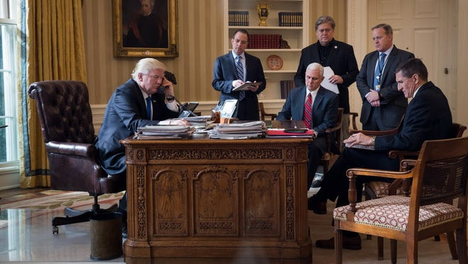 President Trump speaks on the phone with Russian President Vladimir Putin in the Oval Office of the White House Jan. 28.