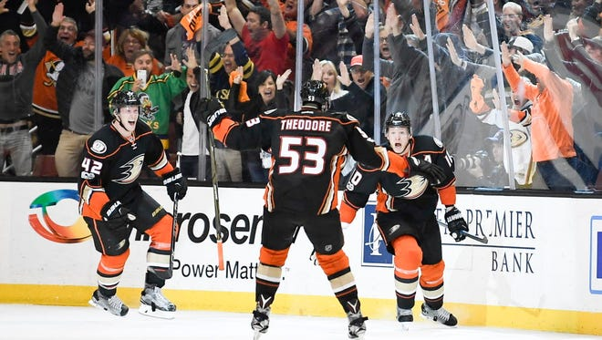 The Anaheim Ducks celebrate after the game-winning goal by Corey Perry (10) in double overtime of Game 5 against the Edmonton Oilers.
