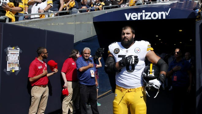Alejandro Villanueva #78 of the Pittsburgh Steelers stands by himself in the tunnel while the national anthem plays prior to the game against the Chicago Bears at Soldier Field, Chicago, on Sept. 24, 2017.