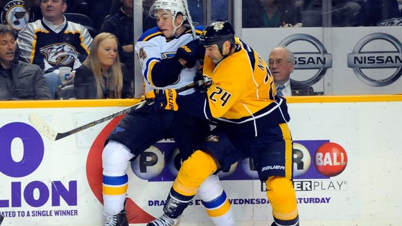 Predators left winger Eric Nystrom hits St. Louis Blues right winger T.J. Oshie during the second period.