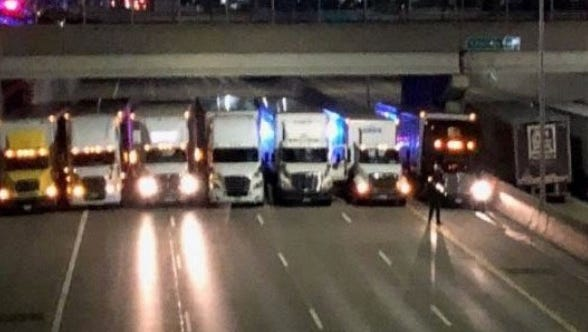 A line of 13 trucks with assistance from Michigan State Police, created a wall on the I-696 freeway near the Coolidge exit to prevent a man from jumping off the overpass.