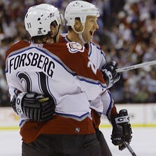 12 Apr 2001:  Rob Blake #4 celebrates with Peter Forsberg #21 of the Colorado Avalanche after scoring the second goal against the Vancouver Canucks during the first period in the first round of the Stanley Cup playoffs at the Pepsi Center in Denver, Colorado.  <DIGITAL IMAGE> Mandatory Credit: Brian Bahr/ALLSPORT