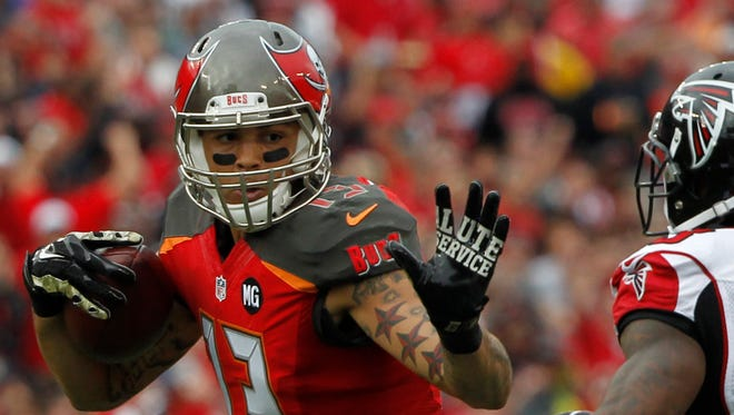 Buccaneers WR Mike Evans was one of a record three rookies to gain 1,000 receiving yards in 2014.