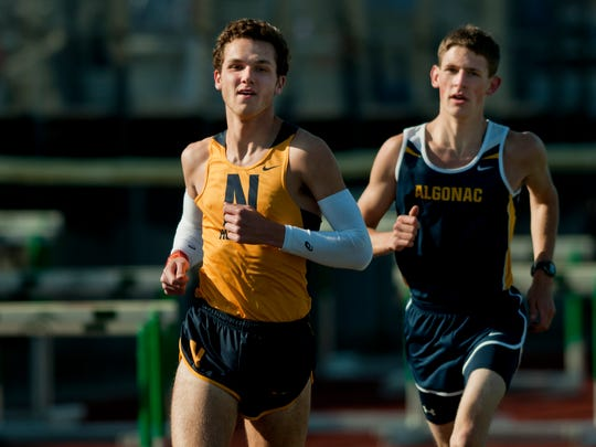 Port Huron Northern senior Matt Thomas and Algonac junior Morgan Beadlescomb compete in the 3,200 meters during the St. Clair Relays track meet April 24 at East China Stadium. The two will meet again Friday in the 1,600 at the Marysville Invitational.