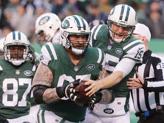 New York Jets quarterback Josh McCown, right, celebrates his touchdown with Brian Winters during the second half of an NFL football game, Sunday, Dec. 3, 2017, in East Rutherford, N.J. (AP Photo/Julie Jacobson)
