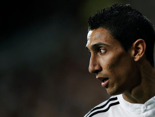 Real Madrid's Angel Di Maria from Argentina reacts during a Spanish Super Cup soccer match against Atletico Madrid at Santiago Bernabeu stadium in Madrid, Spain, Tuesday, Aug. 19, 2014 . (AP Photo/Daniel Ochoa de Olza)