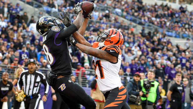 Baltimore Ravens wide receiver Breshad Perriman pulls in a touchdown pass under pressure from Cincinnati Bengals cornerback Darqueze Dennard. Perriman has largely been a disappointment with the Ravens.