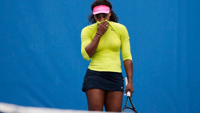 Serena Williamscoughs during a practice session at the Australian Open. She plays in the final against Maria Sharapova.