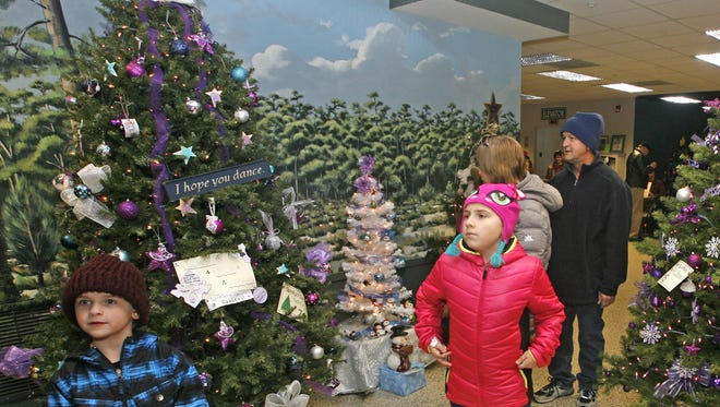 Patti and Bobby Deering along with their children Ben and Nikki of Tuckerton attend The Festival of Trees at the Tuckerton Seaport last year.
