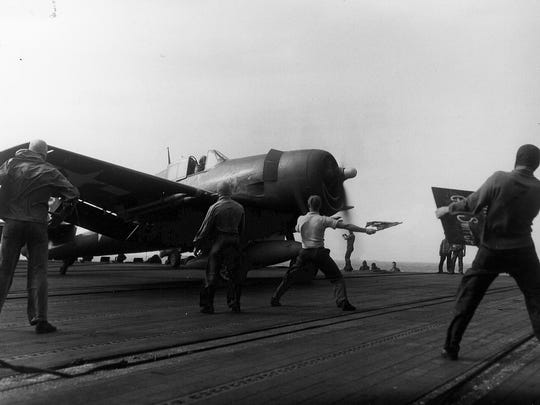 An F6F-5 Hellcat of Fighting Squadron (VF 7) positioned for launch on the flight deck of the carrier USS Hancock (CV 19) during operations against Japanese installations and forces in French Indochina, later called Vietnam.  Hancock later completed numerous combat cruises during the Vietnam War.