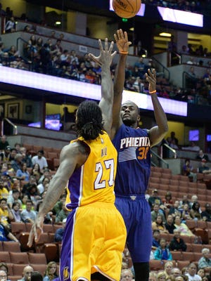 Oct 21, 2014: Phoenix Suns forward Earl Barron (30) shoots over Los Angeles Lakers forward Jordan Hill (27) during the first half at Honda Center.