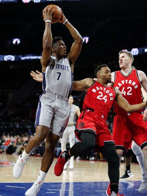 Stanley Johnson takes a shot over Raptors guard Norman Powell (24) during the fourth quarter of the Pistons' 87-75 loss March 17, 2017 at the Palace.