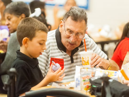 Grandparents visit grandkids for lunch as part of a