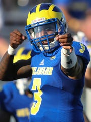 Delaware quarterback Joe Walker pantomimes shooting an arrow after a third quarter touchdown pass in Delaware's 41-14 win against Cornell at Delaware Stadium Saturday.