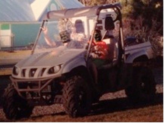 2007 silver and black Yamaha Rhino with a green Monster Energy logo sticker on the front fender.