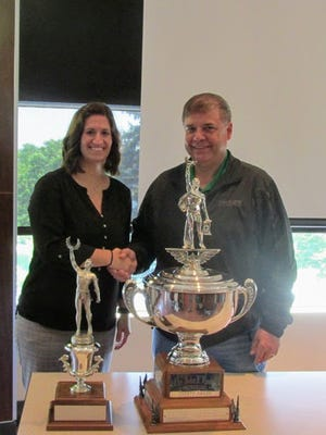 Megan Silcott, EHS coordinator with Nachurs Alpine Solutions accepts the John F. Lacey trophy from Marion Area Safety Council Steering Committee Chair Steve Washburn (Nucor Steel Marion, Inc.).