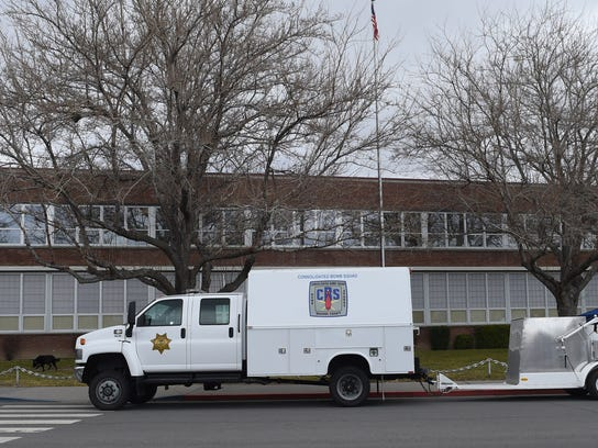 The bomb squad truck is parked outside Sparks High