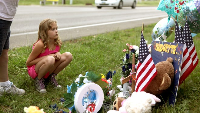 April Baker came to the memorial for Bridgette Shepherd on Monday with her grandmother, Wanda Bruster.