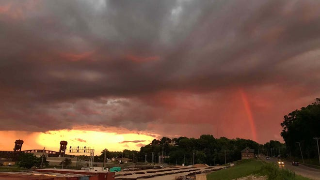 A stormy sunset creates an ominous sky with a rainbow streaking out of the clouds at right Thursday in Burlington. The Hawk Eye wants to see your 2020 summer sunsets for the next edition of the Currents magazine. Please submit one entry per person and include the photographers name and caption information to photo@thehawkeye.com.