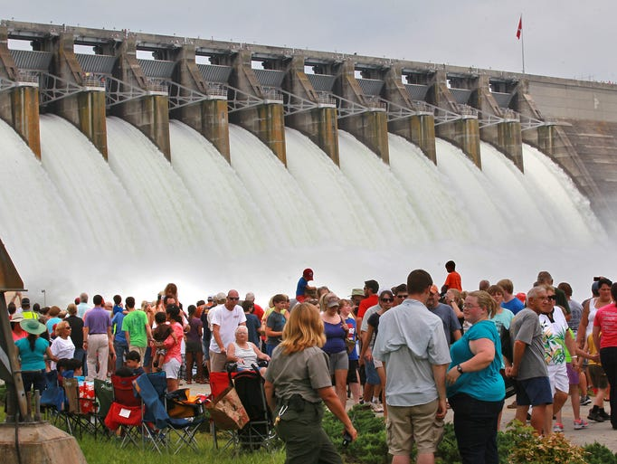 Spectators watch the 12 gates on the Hartwell Dam Project