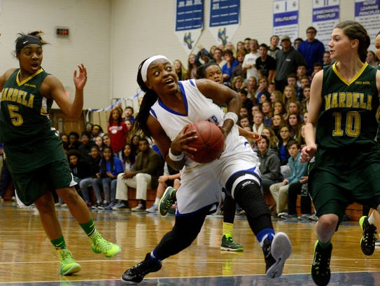 Dayona Godwin braces for contact as she drives the