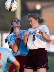 Webster County's Lindsey Grant (right) and Union County's Elizabeth French head the ball as Union County plays Webster County in the Girls District Soccer Tournament in Morganfield Monday, October 10, 2016.