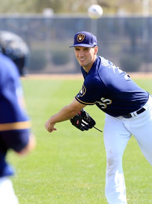 Brent Suter throws live batting practice at Brewers spring training camp Wednesday.