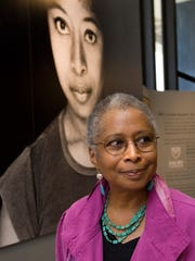 The novelist Alice Walker poses in front of a portrait