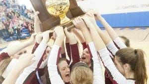 Assumption volleyball team celebrates its fourth straight state championship.