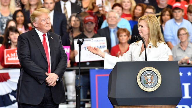 Marsha Blackburn gestures toward President Donald Trump at a Nashville rally during her U.S. Senate campaign in 2018. Sen. Blackburn will speak at the 2020 Republican National Convention in Charlotte, North Carolina.