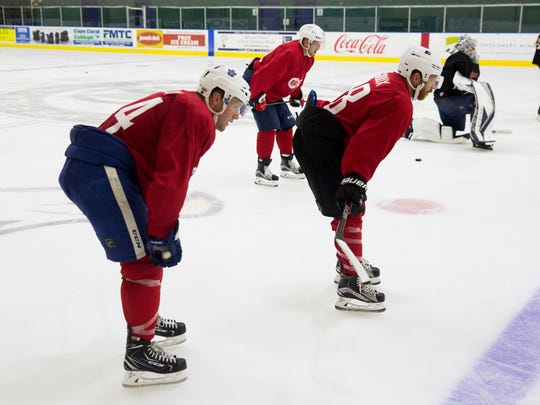 Darryl Belfry teaches hockey players from youth leagues to