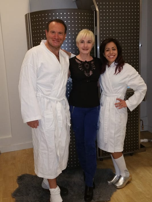Saul Julie Danielle in front of cryotherapy chamber