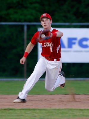 St. Johns' Parker Ackerman makes a catch against Holt Thursday, May 26, 2016, at Kircher Municipal Park.
