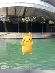 """A Pikachu appears at World's Fair Park in the mobile game, """"Pokemon GO."""""""