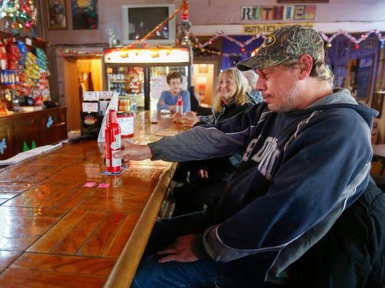 Jim Siegrist enjoys a drink at Ruthie's Bar on Thursday,