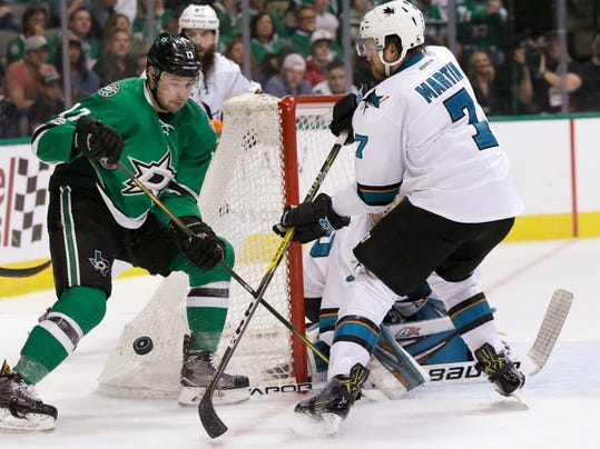 Dallas Stars center Devin Shore (17) skates against San Jose Sharks defenseman Paul Martin (7) during the first period of an NHL hockey game in Dallas, Friday, March 24, 2017. (AP Photo/LM Otero)