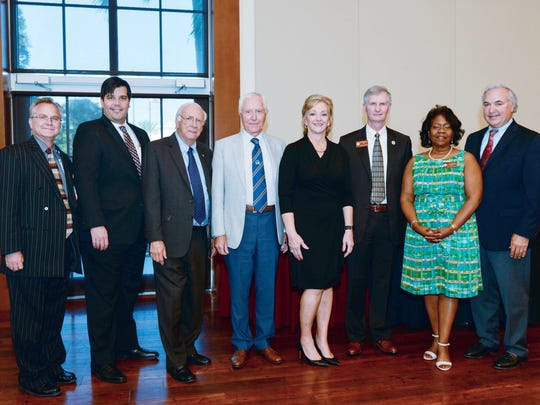 Some members of the FSU College of Medicine Fort Pierce Regional Campus Community Board, from left: Michael Patterson, Eric Goldman, Vernon Smith, Dr. Alastair Kennedy, Karen Davis, Dr. John Fogarty, Dr. Juliette Lomax-Homier,  and Jeff Susi.