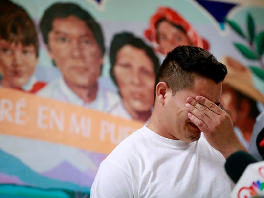 Christian Granados, from Honduras, recounts his separation from his child at the border during a news conference at the Annunciation House in El Paso, Texas on June 25, 2018.