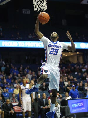 DePaul guard Durrell McDonald scores during the second half of the Blue Demons 87-72 win.