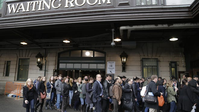 Commuters wait to enter the PATH station in Hoboken, N.J., Tuesday, April 4, 2017. A minor derailment on Monday at Penn Station involving a New Jersey Transit train and other rail issues are causing major problems for New York City metro area commuters. (AP Photo/Seth Wenig)