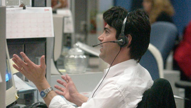 Time-Warner Cable customer service representative Rich Zoran fields a call at the company's headquarters in Kimberly in 2005.