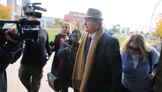 Martin MacDonald leaves City Court on Nov. 9 after pleading not guilty to 2nd-degree harassment in connection with  shoving autistic teen Chase Coleman.