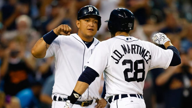 Trading J.D. Martinez, right, in the final year of his contract would make sense for the Detroit Tigers. Do they go for a full rebuild and dangle Miguel Cabrera, too?