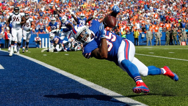 Buffalo Bills fullback Mike Tolbert drops a pass from quarterback Tyrod Taylor during the first half of an NFL football game against the Denver Broncos, Sunday, Sept. 24, 2017, in Orchard Park, N.Y. (AP Photo/Jeffrey T. Barnes)