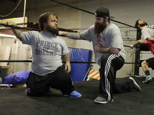 ACW Wisconsin's Dylan Postl and Josh Binder talk during a wrestling practice session in Oshkosh in April 2018.
