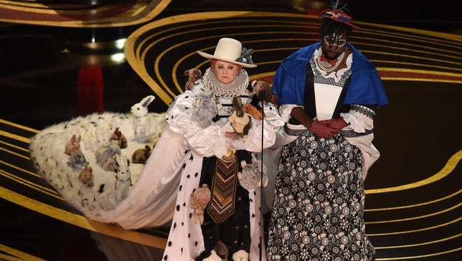 Melissa McCarthy and Brian Tyree Henry present an award during the 91st Annual Academy Awards at the Dolby Theatre in Hollywood, California on February 24, 2019.
