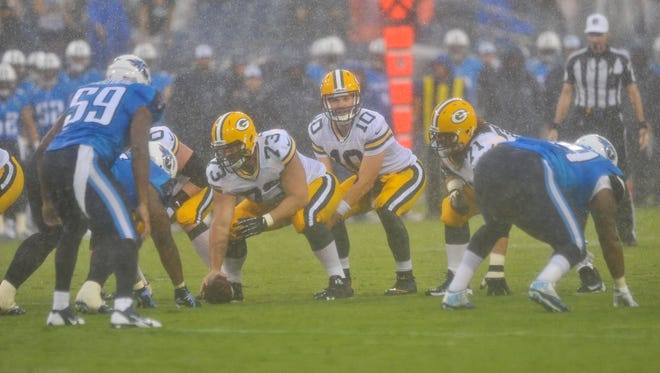 Green Bay Packers quarterback Matt Flynn (10) is set to take the snap from Green Bay Packers center JC Tretter (73) against the Tennessee Titans during the first half at LP Field.