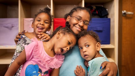Adrienne Brown surrounded by her kids. All of them found a home – and a future – thanks in part to Wheeler Mission.