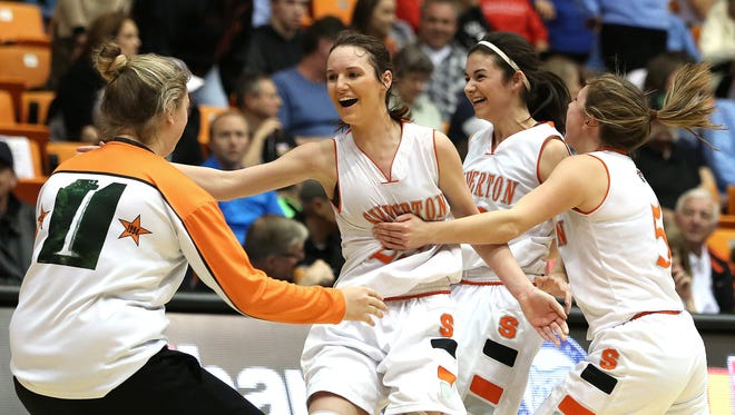 Silverton's Alia Parsons, left, Brooke McCarty and Kayce McLaughlin celebrate the Foxes' 37-36 win against Corvallis in OSAA Class 5A semifinals on Friday, March 11, 2016, at Gill Coliseum at Oregon State University.