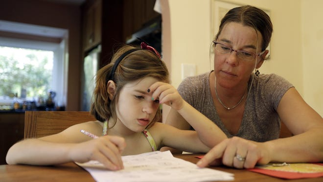 Stacey Jacobson-Francis, 41, of Berkeley, California, said her daughter's homework requires her to know four different ways to add. That is way too much to ask of a first grader. She cant remember them all, and I dont know them all, so we just do the best that we can, she said. (AP Photo)